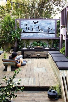 Here's a good way to use your outdoor space wisely - outdoor dining table, movies, lounge chairs, and garden space.