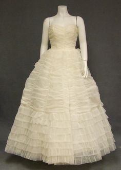 I love the idea of a vintage wedding dress, and this one is beautiful, although Nylon, which is strange.