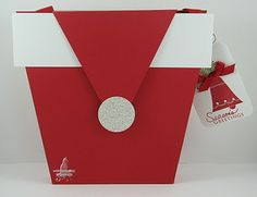 A really cute envelop/gift box in the shape of Santa's Hat!  Cat's Ink.Corporated