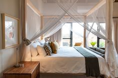 Bedroom with four poster bed and mosquito nets Mosquito Net Bed, Safari Decorations, Four Poster Bed, Curtains With Blinds, My House, Upholstery, Condo, Bedrooms, House Design