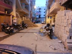 """#Bangalore #SGPalya """"I stay on Venkateshwara Layout 5th Cross, SG Palaya. There are lot of constructions happening on the road. So these people dump the sand and gravel on one side of the road and the debris on the other side. This doesn't allow us to use the road at all."""" - Joslin Julius. Click on the link to VOTE UP Joslin's complaint to get the issue resolved faster: http://bit.ly/1owbLw7"""