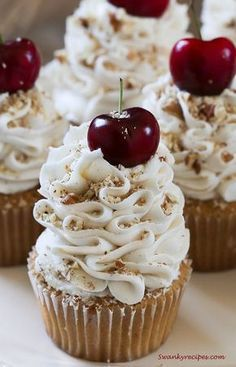 Italian cream cupcakes light airy and rich vanilla buttermilk and almond cupcakes blended with sweetened coconut and pecans topped with the ultimate cream cheese and buttercream frosting with cherries and pecans these cupcakes will quickly become a family Cupcake Recipes, Baking Recipes, Dessert Recipes, Gourmet Cupcakes, Mini Cakes, Cupcake Cakes, Cup Cakes, Cupcake Emoji, Icing Cupcakes