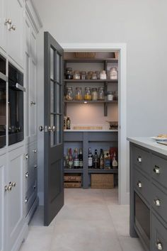 This open plan kitchen in Ingatestone has the perfect walk in pantry. Hidden beh… This open plan kitchen in Ingatestone has the perfect walk in pantry. Hidden behind a Georgian style door painted in H Kitchen Pantry Design, Kitchen Interior, New Kitchen, Kitchen Decor, Kitchen Door Paint, Kitchen Larder Cupboard, Beige Kitchen, Pantry Cabinets, Awesome Kitchen