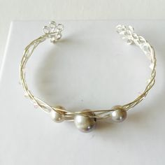 Made a triple silver pearl and Crystal silver wire cuff bracelet!