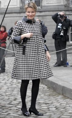 Having been pregnant with four children, Princess Mathilde of Belgium has maternity style down to a science. The blond royal was all about experimenting with fun patterns, choosing a wardrobe full of geometric shapes and unique fabrics while carrying her fourth child, Princess Eleanore, in 2008. Her Royal Highness stole the spotlight in a mod, black and white hounds tooth coat with black vinyl cuffs during a meeting with Britain's Prince Charles in 2008.