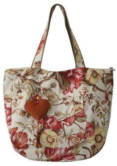 Linda bolsa em lona floral. Ideal para passeio tanto no shopping quanto na  praia. 80a7c371714