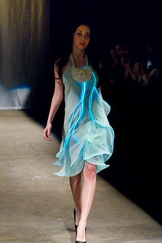 EL Wire Dress by Diana Eng  Aqua silk chiffon organically draped dress edge with electroluminescent wire controlled by an accelerometer. Circuit boards are housed in 3-D printed neck piece.