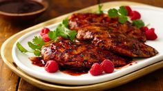 Perk up grilled chicken breasts with sweet raspberry preserves and smoky chipotle chiles.