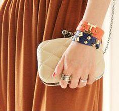 Clutch bag and stud bracelets