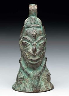 Africa | Bell in the form of a head |  Forcados River style.  Lower Niger Bronze Industry, Nigeria | Cast copper alloy | 16th to 19th century