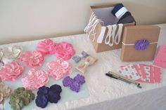 What a fun girl baby shower idea! Headband making station.