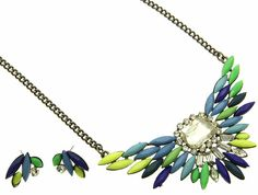 Full of Winter. Snowdrifts. Cabin Fever.  At least you look good while you plot how to stay alive.  Shourouk rhinestones, colored stones, and lucite on a dark metal chain. Necklace is 16 inches long.
