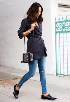 Aimee Song of Song of Style in a belted blazer, skinny jeans, and oxfords