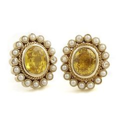 Old world luxury oozes from these classy yellow sapphire-and pearl earrings, redesigned for today's woman of substance. Note the fine details like the gold 'braid' motif and unexpected glint of...  From Rasvihar  http://www.parisera.com/collections/cleosara