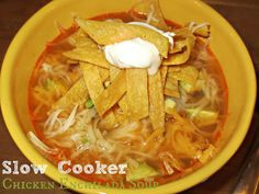 Slow Cooker Chicken Enchilada Soup - This looks oh so yummy and I think it'd be freezable...just add garnishes after reheating.