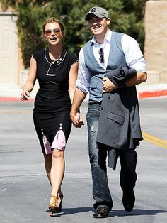 SHOP TO IT Britney Spears holds tight to supposed new beau David Lucado during a shopping trip Friday afternoon in Thousand Oaks, Calif.