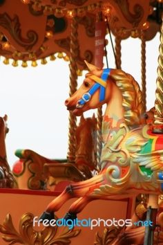 "Fairground Carousel Stock Photo By Simon Howden, published on 01 May 2009 - Stock Photo - image ID: 1006096  Detail of a colourful fairground carousell ride with colourful carved horses, located on the pier at Weymouth, Dorest UK.  This royalty free photo, ""Fairground Carousel"", can be used in business, personal, charitable and educational design projects: it may be used in web design, printed media, advertising, book covers and pages, music artwork, software applications and much more."
