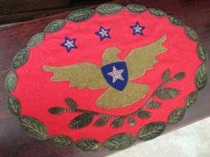 Wool appliqué. Hand stitched by Mary Ann Thom. Vintage Redware Eagle from Pretty Penny Precuts.