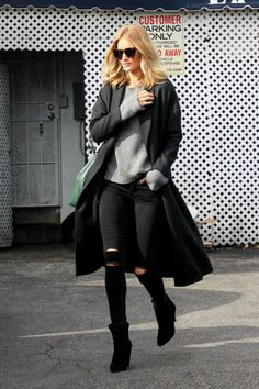 Rosie Huntington-Whiteley goes for an elongated look in black Paige jeans and boots for endless legs and topping it off with a long black AYR coat.