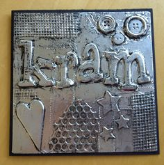 Metal tape art - glue buttons, foam shapes and letters, pieces of wire etc. to create composition; cover with foil -