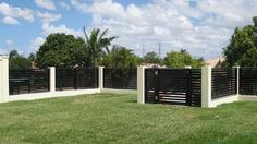 COLORBOND® STEEL Clik'n'Fit® fence infills with slats and gate in Nightsky®