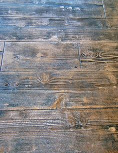 At first glance, this floor looks like it's made from rustic hardwoods. In reality, it's concrete that has been refinished and stamped to achieve this texture and finish. Unlike hardwoods, decorative concrete stamped to look like wood doesn't involve cutting down any trees, and is significantly less expensive.