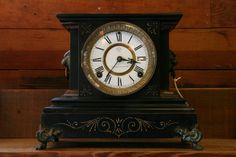 """Antique Ansonia """"La Duchesse"""" Mantel Clock: Ansonia clocks are a piece of American artisan history. The Ansonia Clock Company began in the 1850s in Connecticut and continued until 1929 when the company fell on hard times and sold its remaining materials to the Soviet Union. The """"La Duchesse"""" mantel clocks were in production between 1879 - 1889 and this has an 8-day time/strike, enameled iron case, porcelain face and beveled glass. Sold as is as it needs a pendulum.  $225"""