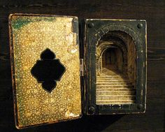 Tunnel Book by Ruth Maendel, constructed of an old German Bible. Hard to see in the photo, but it's got tiny doors at the very back.