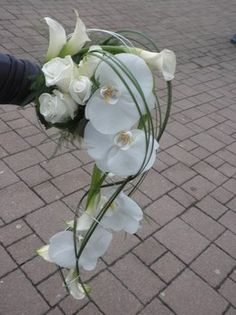 Wedding bouquet with phalaenopsis and roses