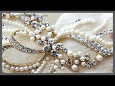 "Video- Fabric Jeweled Vintage Hair Clip ~ Mandy - This elegant vintage inspired bridal hair clip features rich champagne ivory fabric ""petals"" accented with pearls and rhinestones.   This piece is perfect for your vintage bride or any romantic wedding day look!"