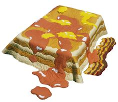 Pancakes, Butter & Syrup Quilt and Bacon Rug. I like the food, but to sleep under it? That's just weird.