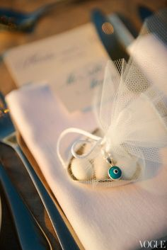 Bombonieres, a traditional party favor, are given at almost every Greek wedding. Candy-covered almonds in a silver dish are wrapped up with white tulle. Attached to the white ribbon is a mati, or evil eye, a Greek talisman and the perfect parting gift. Almond Wedding Favours, Wedding Favors, Our Wedding, Wedding Gifts, Destination Wedding, Dream Wedding, Wedding Candy, Greek Wedding Theme, Wedding Stuff