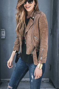 What to wear out this weekend? Try a brown suede moto jacket with  distressed jeans, cuffs, and cat-eye sunglasses back to core closet pieces  like layered rings (I live in this ring and layer on these as well), small  shoulder bag (this is a personal favorite in the mini-bag category), and  ankle strap sandals (I get serious use out of these sandals):  found on tumblr.com   Perfect for: Pear & Hourglass Body Types  GET THE LOOK. SHOP STYLIST-APPROVED SIMILAR ITEMS:  More Outfit Ideas