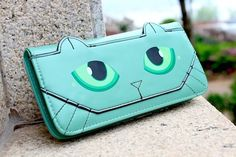 Something unique you wont find on the High Street! This mesmerizing green cats eyes purse brings women's purse designs to a whole new level! With a one-of-a-kind style on the outside, it won't disappoint on the inside either! The vast interiors offer twelve card slots, three compartments for notes or a mobile phone and zipped coin compartment. Plenty of space for your everyday needs!