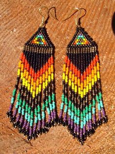 Native American seed beaded rainbow beauties long. #beadwork