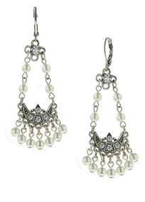 With an ornamental vintage feel these earrings dance from your ears.   A four petal metal flower hangs from the comfortable lever back setting and leads to the festive feeling crescents.  Pearls dangle from the sideways crescents which are antiqued and set with crystals.  These are truly a formal and fun set of earrings