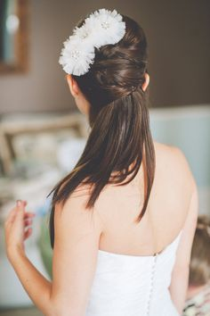 What about something like this with a slight curl-under at the bottom??  wedding hair for girls with straight hair