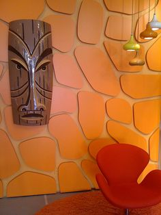 Crazy about how they did the tiling on the walls. That red chair is one of my faves, and the large Shag (or Shag-like) tiki is awesome.