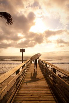 Surfer on a boardwalk, The Washout, Folly Beach, SC repinned by www,facebook.com/loveswish