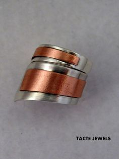 The artist likely sweat soldered while the metal was flat, then formed.  creating a tagboard model would be advised to one could check the sizing and where the wrap-around begins and ends.  Ring of linear design, where the contrast between the two metals, copper with silver or brass with silver highlights. It is an original model both by