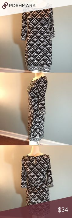 """WHBM Black & White Knit Dress In great condition, this lined dress is made of 95% polyester/5% cotton so has lots of give. Fun geometric pattern with contrasting pattern on sleeve and hem. Bust 30"""" and length 34"""" White House Black Market Dresses"""
