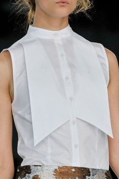 Displaced Collar - a simple sleeveless shirt with exaggerated collar tips; fashion design details // Christopher Kane