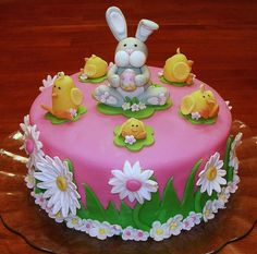 """Easter Bunny and Chicks Cake~ Easter Bunny and Chicks Cake ~ 9"""" 4 layer German Chocolate cake. Covered with fondant and decorated with all hand-made Easter decorations. Photo only for inspiration."""