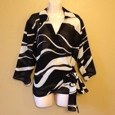 Lane Bryant Black & Ivory Sheer Wrap Blouse/Top Sheer black & ivory wrap blouse. I love this top but it's too big for me now. Great item to add to any fashionista's closet Lane Bryant Tops Blouses