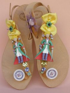 Handmade leather sandals with cartoon, buttons with swarovski flat back, swarovski fancy stones, French ribbons, metallic daisies with swarovski rhinestones, French gros grain ribbons and ceramic bead