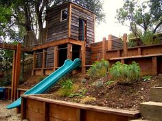 Creative Outdoor Playhouse series:  two story playhouses (like that this is part of the landscaping)