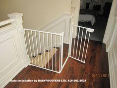 Baby gate for irregular stair opening.