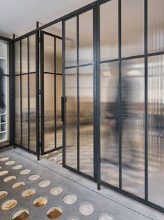 The glass partition doors assist in opening the space up, while also enhancing the natural light. Tagged: Doors, Metal, Interior, and Swing Door Type. Photo 9 of 11 in A London Townhouse Has Glass Circles in Its Floors to Filter in Ample Natural Light. Georgian Terrace, Georgian Townhouse, London Townhouse, Georgian House, Architecture Restaurant, Architecture Details, Interior Architecture, Interior Design, Gym Interior