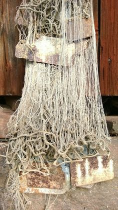 An old net with rustic metal weights