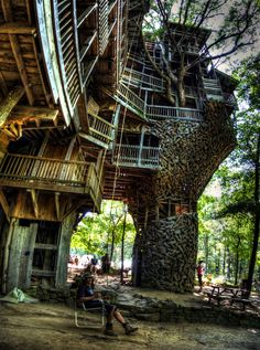 biggest tree house ever - Horace Burgess's treehouse is located somewhere near Crossville, Tennessee and stands over 97-feet tall thanks to the 80-foot white oak tree it was built around which also happens to be about 12-feet in diameter at its base. It has 11 floors, somewhere in the neighborhood of 8,000 to 10,000 square feet, a miniature basketball court and is held together by roughly 258,000 nails.